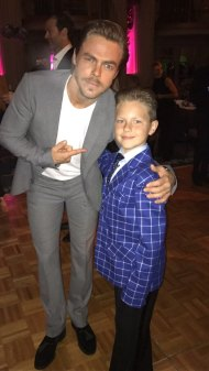Derek at the Royal Ball Dinner with one of the little dancers - March 18, 2017 Courtesy derekhough IG