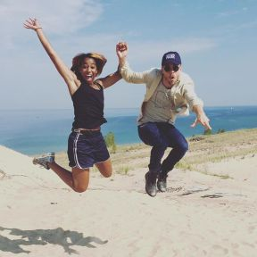 """Me: let's doing a jumping pic Derek: ok let's hold hands 😂 Exploring Indiana Dunes with @derekhough! #TravelWriter"" Courtesy cassmulababy ig"
